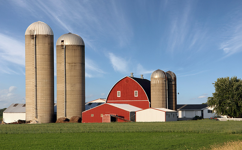 Rural farm scene with a dramatic sky