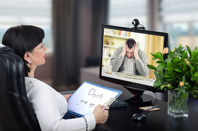 Virtual psychotherapist intends to help to depressed man through telehealth mental health appointment