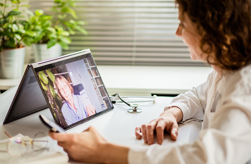 clinician meeting with elderly woman for telehealth telemedicine appointment