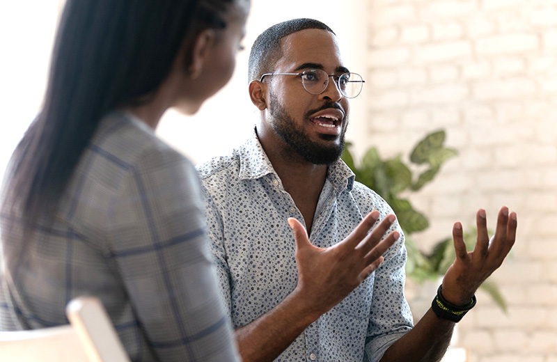 young african american male psychologist meeting patients