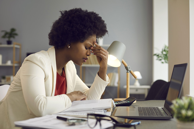 A woman feeling tired and stressed, overworked, burnout and fatigue.